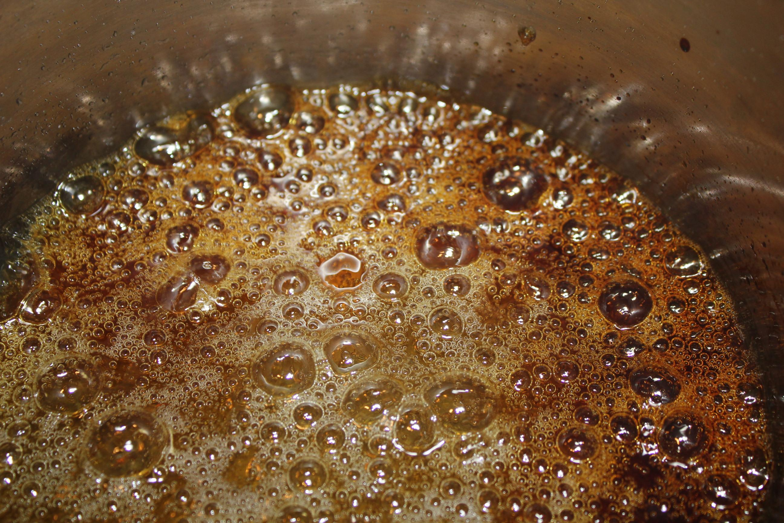 Sugar caramelizing into a deep golden color
