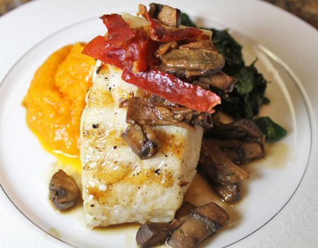 Seabass with Porcini Mushroom Sauce, Butternut Squash Puree, Sauteed Spinach and Crispy Proscuitto Garnish