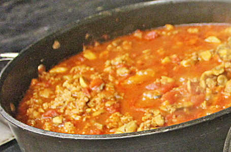 Tomato-Sausage Sauce simmering on stovetop