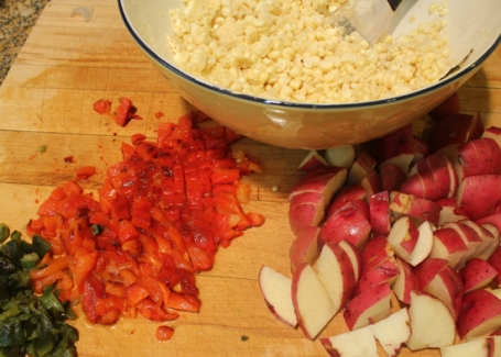 Roasting the bell peppers and pasilla chile before adding to the soup adds another layer of flavor.
