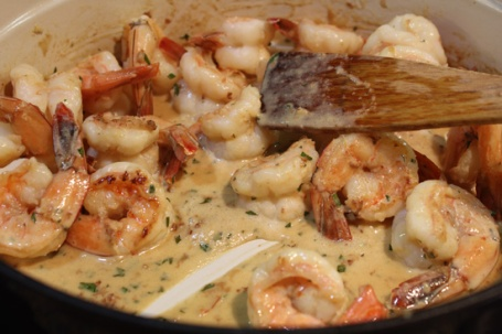 The final step - add the shrimp back to the pan.