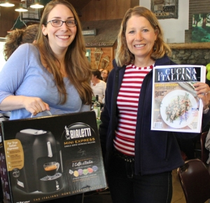 Jennifer Farley of Savory Simple accepts the Bialetti machine for winner, Chung-Ah Rhee of Damn Delicious.