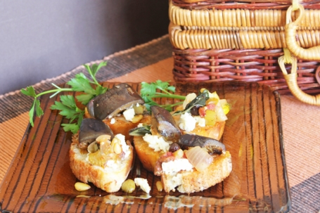 Caponata served on toast with feta cheese.