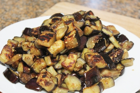 Eggplant is fried until soft and caramelized