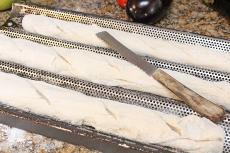 Place the dough into the 3 barrel pan and cut diagonal slices along with top with a serrated knife.