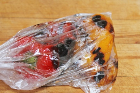 Peppers are roasting in a plastic bag.  Keep them in the bag for 5 minutes or longer.
