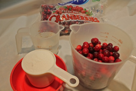 Assemble 1 package of fresh cranberries, 1 cup of sugar and 1 cup of water.