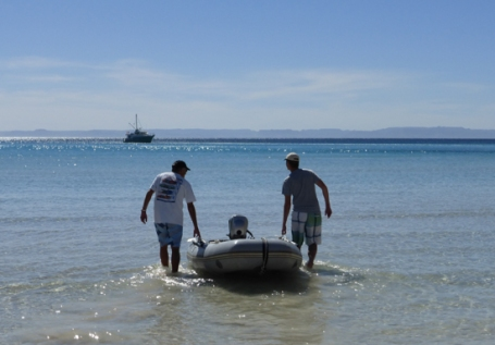 Captain Kurt and Chris heading out to our yacht, Endurance at Ensenada Grande cove.