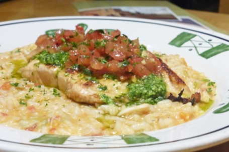 The Olive Garden's Salmon Bruschetta sits on a wonderful risotto.